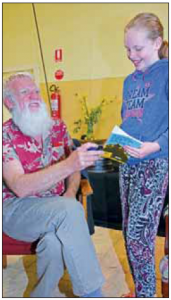 Matilda McInnes of Metung chatting with Bruce Pascoe